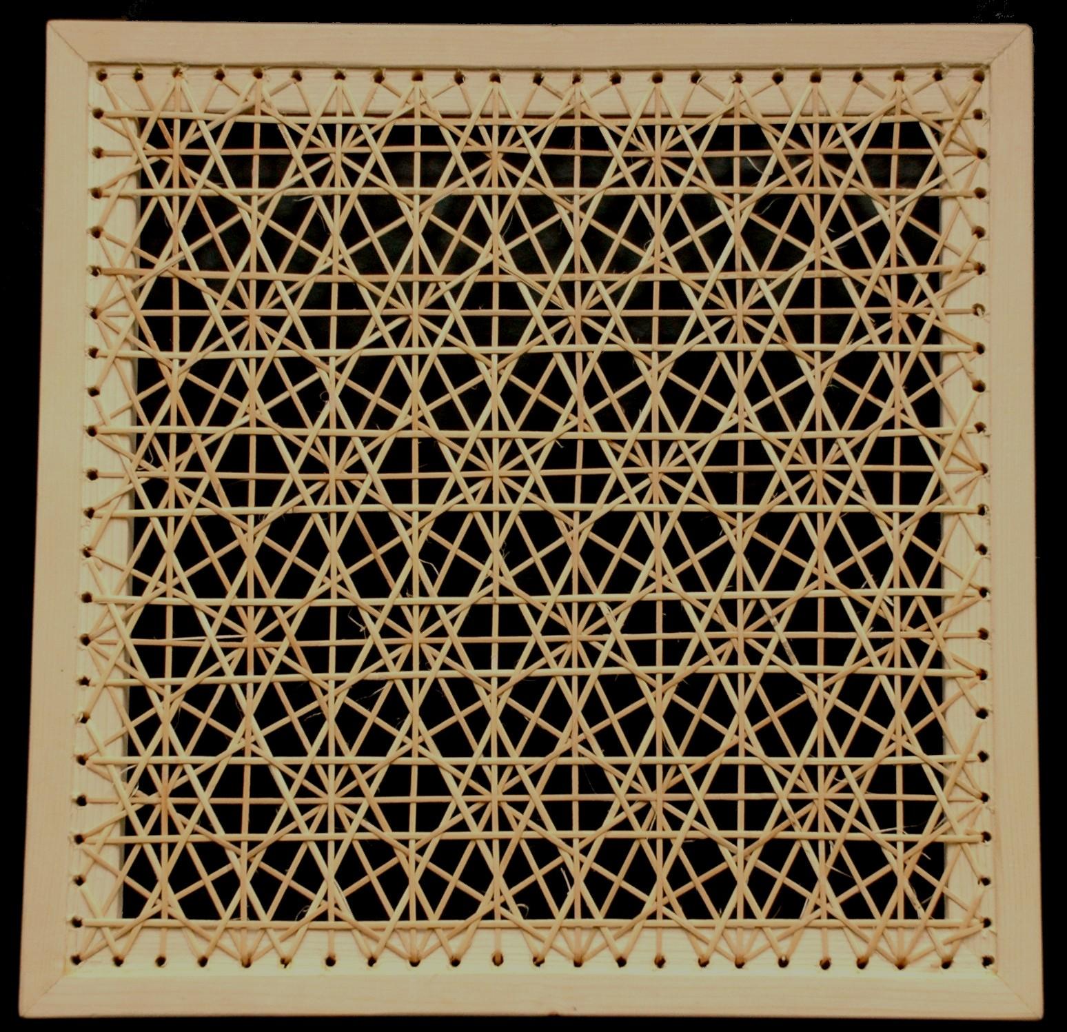 gaatjesmat motief spinnenweb met rotan gevlochten